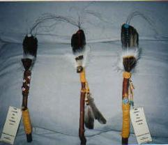 Talking sticks ( L' Eagle feather with Arbutus branch )  $200.00  beaded
